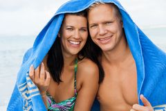 Cheerful couple with a towel covering their heads Stock Image