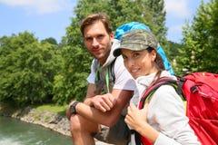 Cheerful couple on a trip stock photos