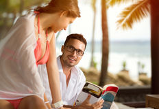 Cheerful couple at tropical resort. Enjoying together Stock Image