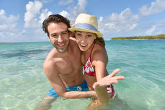 Cheerful couple in turquoise seawater Stock Photo
