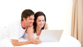 Cheerful couple using a computer Stock Image