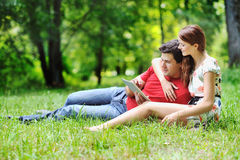 Cheerful couple using digital tablet Royalty Free Stock Photography
