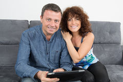 Cheerful couple using digital tablet Stock Images