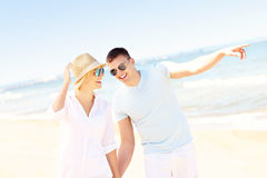 Cheerful couple walking along the beach Royalty Free Stock Photography