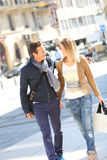 Cheerful couple walking in the streets shopping Royalty Free Stock Images