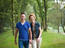 Cheerful couple walking together in the woods Royalty Free Stock Images