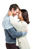 Cheerful couple in warm clothing embracing each other Stock Image
