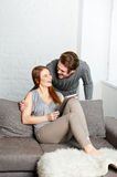Cheerful couple watching photos on internet with tablet Stock Photography