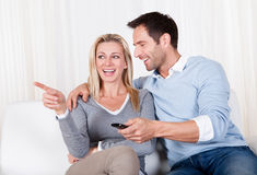 Cheerful couple watching TV Royalty Free Stock Photo