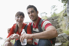 Cheerful Couple With Water Bottle Outdoors Stock Photos