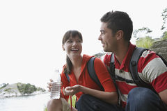 Cheerful Couple With Water Bottle Outdoors Stock Photo