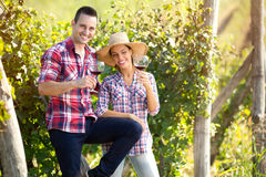 Cheerful  couple of winegrowers drinking wine Stock Photo