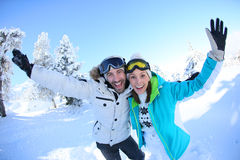 Cheerful couple on winter holidays in snow stock images