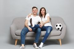 Cheerful couple woman man football fans in white t-shirt cheer up support favorite team with soccer ball showing tongue stock photography