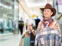 Cheerful cowboy shopping Stock Images