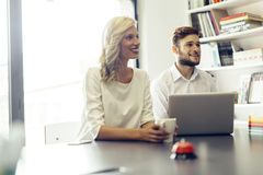 Cheerful coworkers in office Stock Photo