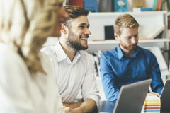 Cheerful coworkers in office Royalty Free Stock Images