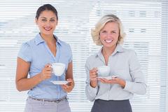 Cheerful coworkers smiling Stock Photos
