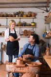 Cheerful craftsman talking to woman colleague Stock Photography