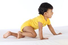 Cheerful crawling baby. Against white background stock photos