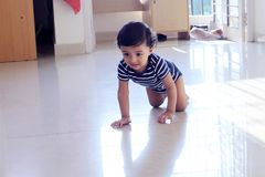 Cheerful crawling baby stock images
