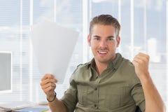 Cheerful creative business employee raising his arms Stock Photos