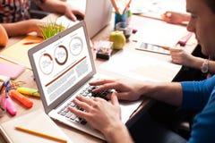 Cheerful creative team is using modern technologies Stock Photo