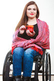 Cheerful crippled lady on wheelchair. Disability drink relax leisure concept. Cheerful crippled lady on wheelchair. Smiling disabled girl holding red cup Royalty Free Stock Photography