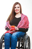 Cheerful crippled lady on wheelchair. Disability drink relax leisure concept. Cheerful crippled lady on wheelchair. Smiling disabled girl holding red cup Stock Photography