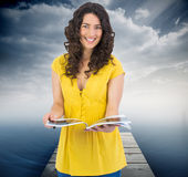 Cheerful curly haired brunette reading magazine Stock Images