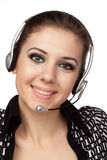 Cheerful customer service operator. Closeup of cheerful customer service operator with headset over white Royalty Free Stock Photos