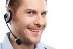 Cheerful customer service representative speaking into microphone royalty free stock photo
