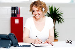 Cheerful customer support executive at work Stock Photography