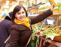 Cheerful customer at the vegetable market Royalty Free Stock Images