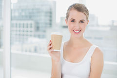 Cheerful cute blonde holding mug of coffee Stock Images