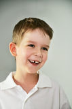 Cheerful cute boy portrait. the boy opened his mouth and lost a Royalty Free Stock Photos