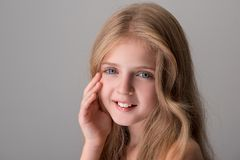 Cheerful cute child is feeling pleasure from her skin stock photo