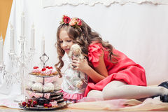 Cheerful cute girl plays with handmade doll Royalty Free Stock Image