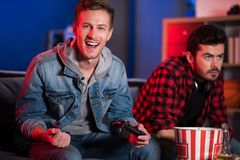 Cheerful cute male gamer is feeling joy royalty free stock photos