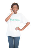 Cheerful cute volunteer having a phone call Royalty Free Stock Images