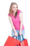 Cheerful cute woman enjoying freetime and doing shopping Stock Photos