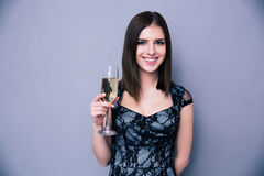 Cheerful cute woman holding glass of champagne Royalty Free Stock Photography