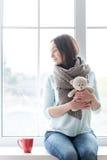 Cheerful cute woman holding a teddy bear Stock Photography