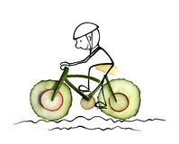 Cheerful cyclist on a bike vegetable Royalty Free Stock Image