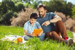 Cheerful daddy spending time with his son Stock Images