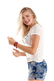 Cheerful dancing girl jumping short on white background flying hair Stock Photography