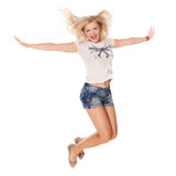 Cheerful dancing girl jumping short on white background flying hair Royalty Free Stock Photos