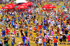 Cheerful dancing people bright view. Thousands of people ubiquitous merriment dancing cheerful at Rhodope Mountains meadow.Every 4th year in July, Bulgarians of Stock Images