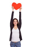 Cheerful dark-haired girl holding a heart over head Stock Photo