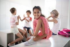Cheerful dark-skinned girl feeling happy after PE class